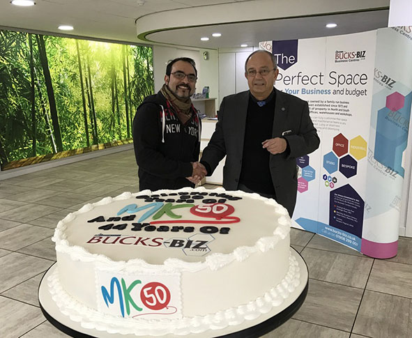 Bucks Biz Business Centres owner Joe Muscat, right, with cake maker Hasnain Somji and the cake