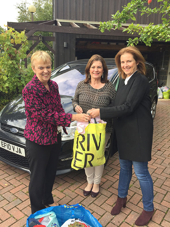 Fran and Marta present the clothes to Isabel Binns from MK Act