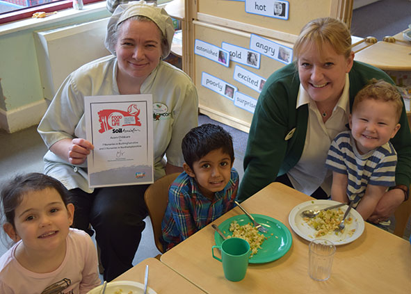 Nursery children enjoying lunch with Sarah Nicholls (Nursery Chef) and Janette Redrup (Senior Nursery Manager)