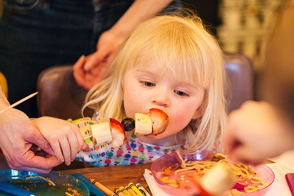 Girl tasting food at The Anchor in Aspley Guise