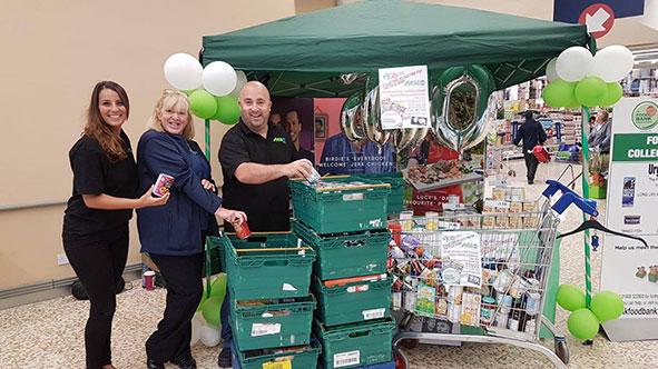 MKFM Darren Dorrington collecting tins in Kingston Tesco