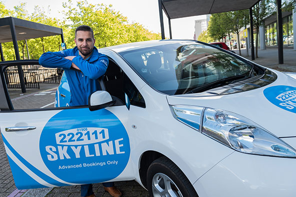 Skyline Taxis owner Gavin Sokhi with a Nissan Leaf Taxi