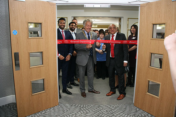 Councillor David Hopkins cuts the ribbon of brand new Newton Leys Care Home