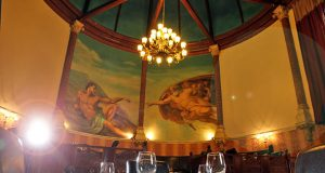 """The famous iconic """"The Creation of Adam"""" mural at Calcutta Brasserie"""