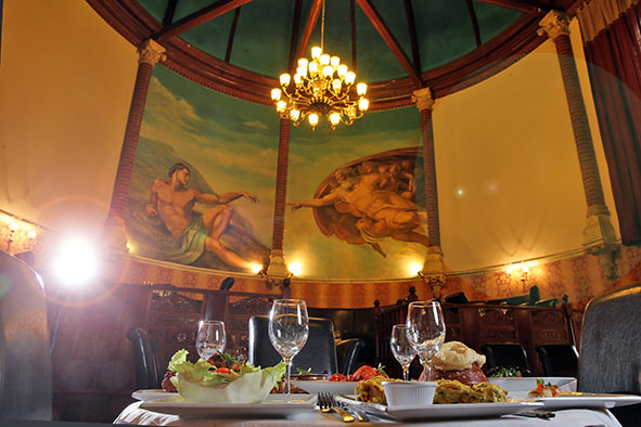 "The famous iconic ""The Creation of Adam"" mural at Calcutta Brasserie"