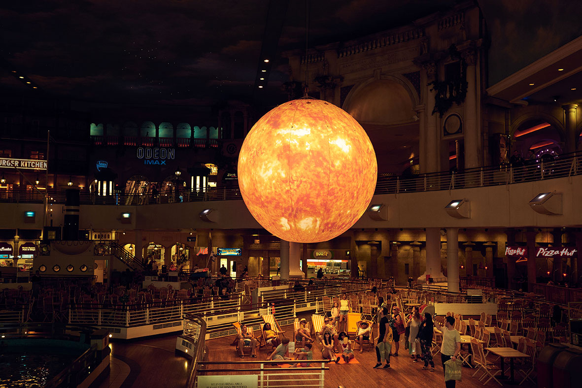 Giant sun at into Trafford