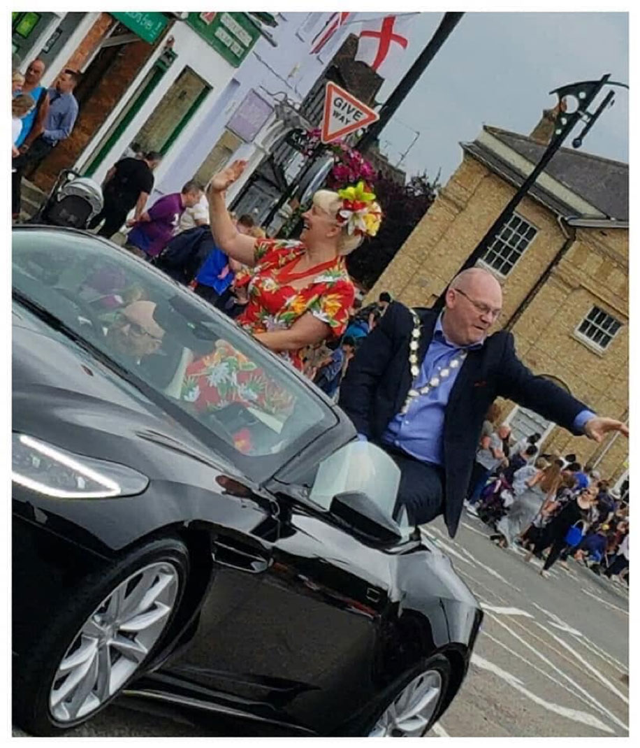 Mayor of Newport Pagnell is driven through the town in an Aston Martin