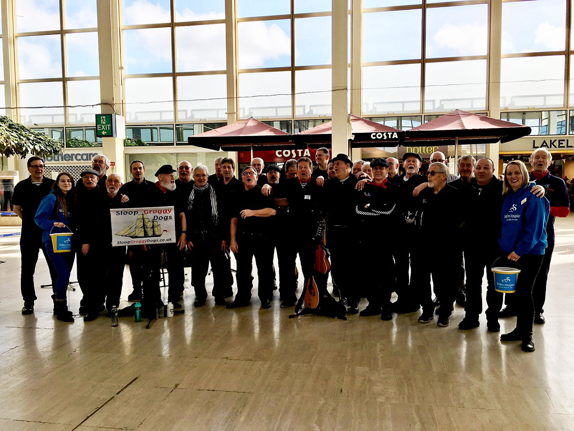 male singers surprise shoppers in centre:mk