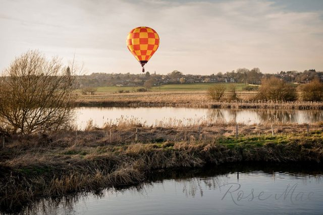 Hot air balloon over wetlands in the Nene Valley