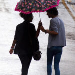 1024px-Couple_sharing_an_umbrella_in_Nottingham,_England
