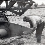 On-the-farm—Brian-fixing-a-combine